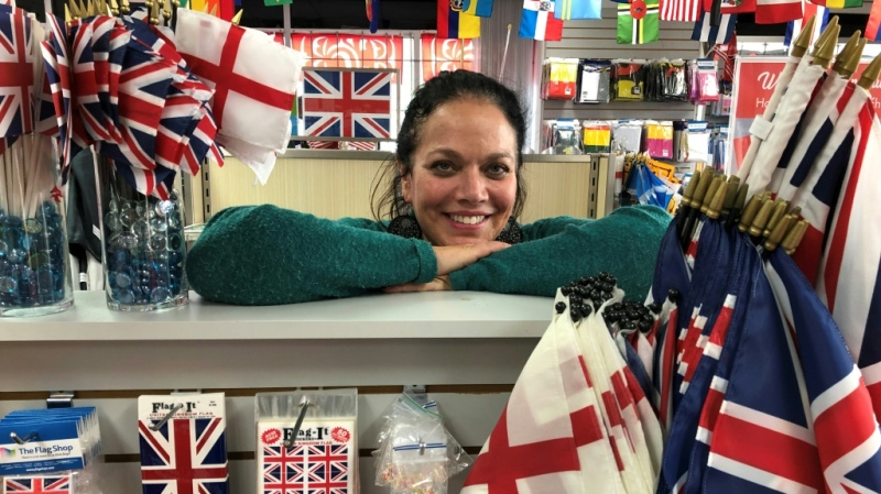 Susan Braverman, president of The Flag Shop in Vancouver, says there's been an uptick in local demand for the Union Jack and Saint George's Cross flags since Prince Harry and Meghan announced their move to Canada. (AFP)