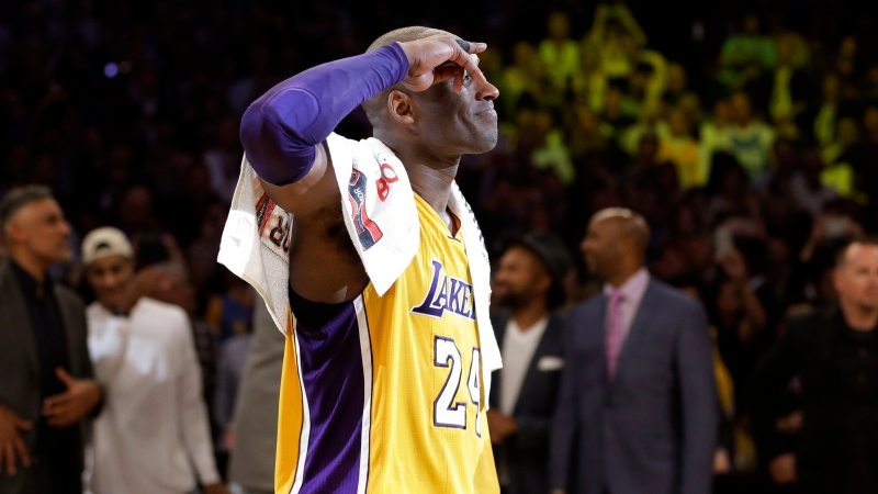 In this April 13, 2016 file photo Los Angeles Lakers' Kobe Bryant acknowledges fans after the last NBA basketball game of his career against the Utah Jazz in Los Angeles. (AP Photo/Jae C. Hong, file)