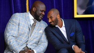 FILE - Shaquille O'Neal, left, and Kobe Bryant chat at the unveiling of a statue of O'Neal in front of the Staples Center in Los Angeles on March 24, 2017.  (AP Photo/Mark J. Terrill)