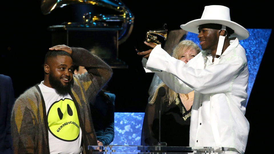 Calmatic, left, and Lil Nas X accept the award for best music video for
