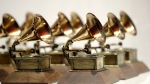 FILE - In this Oct. 10, 2017, file photo, various Grammy Awards are displayed at the Grammy Museum Experience at Prudential Center in Newark, N.J. (AP Photo/Julio Cortez, File)
