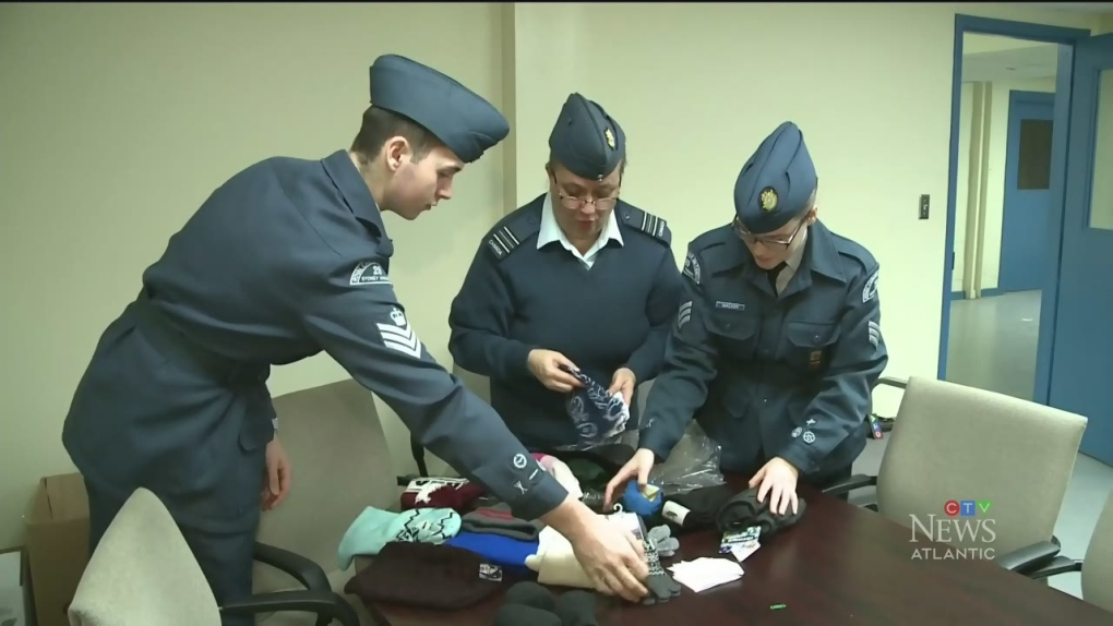 Cadets in Sydney, N.S., offer warm garments to those in need