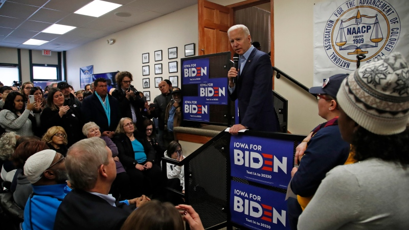 Democratic presidential candidate former Vice President Joe Biden, right, listens to a question during an NAACP block party at Urban Dreams in Des Moines, Iowa, Sunday, Jan. 26, 2020. (AP Photo/Gene J. Puskar)