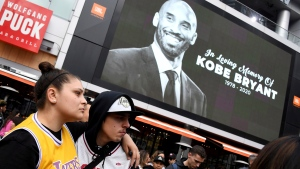 Fans mourn the loss of Kobe Bryant in front of La Live across from Staples Center, home of the Los Angeles Lakers in Los Angeles on Sunday, Jan, 26, 2020. (Keith Birmingham/The Orange County Register via AP)