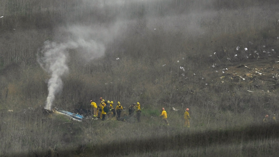 Firefighters work the scene of a helicopter crash that killed former NBA basketball player Kobe Bryant Sunday, Jan. 26, 2020, in Calabasas, Calif. (AP Photo/Mark J. Terrill)