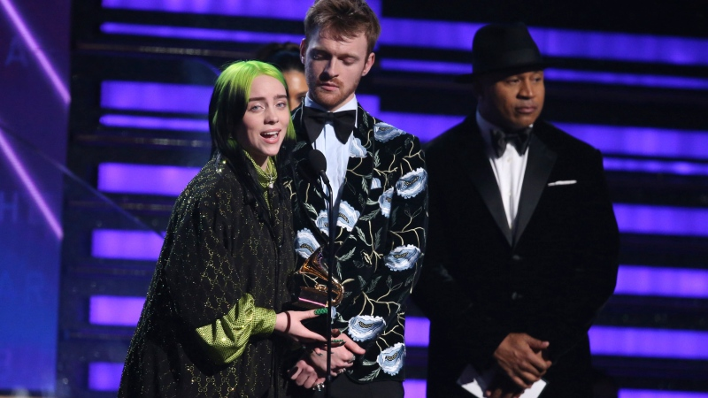 "Billie Eilish, left, and Finneas O'Connell accept the award for album of the year for ""When We All Fall Asleep, Where Do We Go?"" at the 62nd annual Grammy Awards on Sunday, Jan. 26, 2020, in Los Angeles. (Photo by Matt Sayles/Invision/AP)"