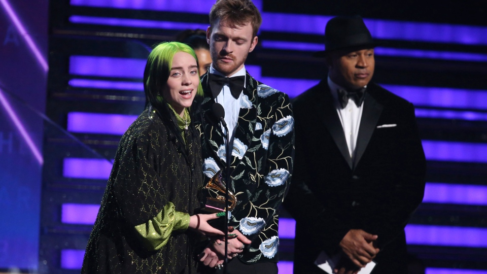 Billie Eilish, left, and Finneas O'Connell accept the award for album of the year for