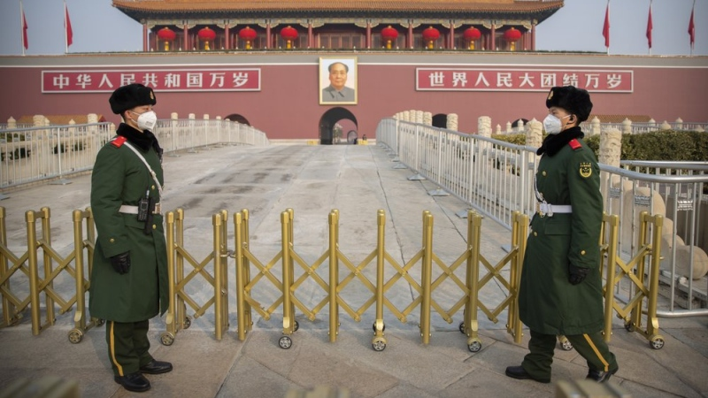 Paramilitary police wear face masks as they stand guard at Tiananmen Gate adjacent to Tiananmen Square in Beijing, Monday, Jan. 27, 2020. (AP Photo/Mark Schiefelbein)