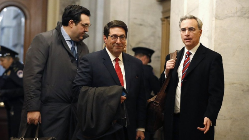 Trump's personal attorney Jay Sekulow, center, stands with his son, Jordan Sekulow, left, and White House Counsel Pat Cipollone, while arriving at the Capitol in Washington during the impeachment trial of U.S. President Donald Trump Saturday, Jan. 25, 2020. (AP Photo/Julio Cortez)