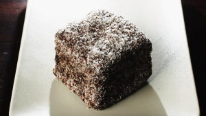 A lamington, the national cake of Australia, is a sponge cake dipped in chocolate and coated in desiccated coconut. (Ian Waldie/Getty Images/CNN)