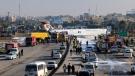 An Iranian passenger plane sits on a road outside Mahshahr airport after skidding off the runway, in southwestern city of Mahshahr, Iran, Monday, Jan. 27, 2020. (Mohammad Zarei/ISNA via AP)