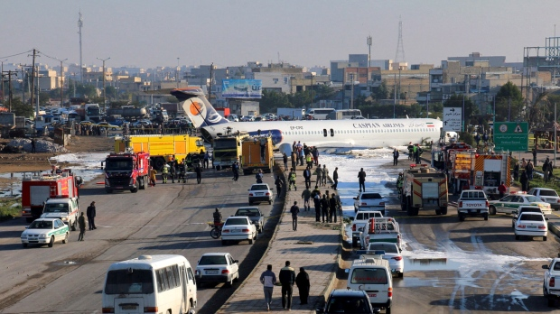 An Iranian passenger plane sits on a road outside Mahshahr airport after skidding off the runway, in southwestern city of Mahshahr, Iran, Monday, Jan. 27, 2020. (Mohammad Zarei/ISNA via AP)