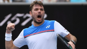 Switzerland's Stan Wawrinka reacts during his fourth round singles match against Russia's Daniil Medvedev at the Australian Open tennis championship in Melbourne, Australia, Monday, Jan. 27, 2020. (AP Photo/Andy Brownbill)