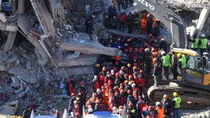 Rescue workers continue to look for people trapped under debris following a strong earthquake that destroyed several buildings on Friday, in Elazig, eastern Turkey, Sunday, Jan. 26, 2020. (AP Photo)