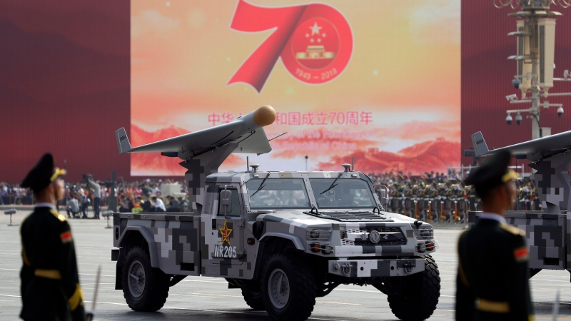 A Chinese military truck carrying an aerial vehicle rolls during a parade to commemorate the 70th anniversary of the founding of Communist China in Beijing, Tuesday, Oct. 1, 2019. Trucks carrying weapons including a nuclear-armed missile designed to evade U.S. defenses rumbled through Beijing as the Communist Party celebrated its 70th anniversary in power with a parade Tuesday that showcased China's ambition as a rising global force. (AP Photo/Mark Schiefelbein)
