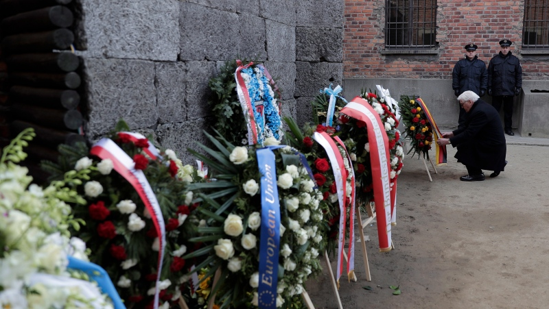 Germany's President Frank-Walter Steinmeier lays a wreath at the Death Wall at the Auschwitz I Nazi death camp in Oswiecim, Poland, Monday, Jan. 27, 2020. Heads of State and survivors of the Auschwitz-Birkenau death camp gathered Monday for commemorations marking the 75th anniversary of the Soviet army's liberation of the camp, using the testimony of survivors to warn about the signs of rising anti-Semitism and hatred in the world today. (AP Photo/Markus Schreiber)