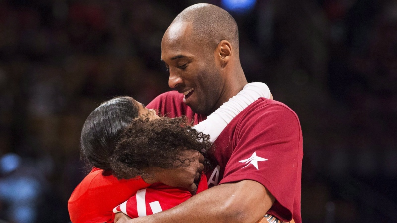 Los Angeles Lakers' Kobe Bryant (24) hugs his daughter Gianna on the court in warm-ups before first half NBA All-Star Game basketball action in Toronto on Sunday, February 14, 2016. Kobe Bryant, the 18-time NBA All-Star who won five championships and became one of the greatest basketball players of his generation during a 20-year career with the Los Angeles Lakers, died in a helicopter crash Sunday. Bryant's 13-year-old daughter Gianna also was killed. THE CANADIAN PRESS/Mark Blinch