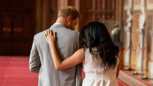 In this Wednesday May 8, 2019 file photo Prince Harry and Meghan, Duchess of Sussex, leave after a photo call with their newborn son, in St George's Hall at Windsor Castle, Windsor, south England. (Dominic Lipinski/Pool via AP, File)