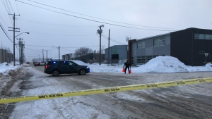 police on scene, west end commercial building