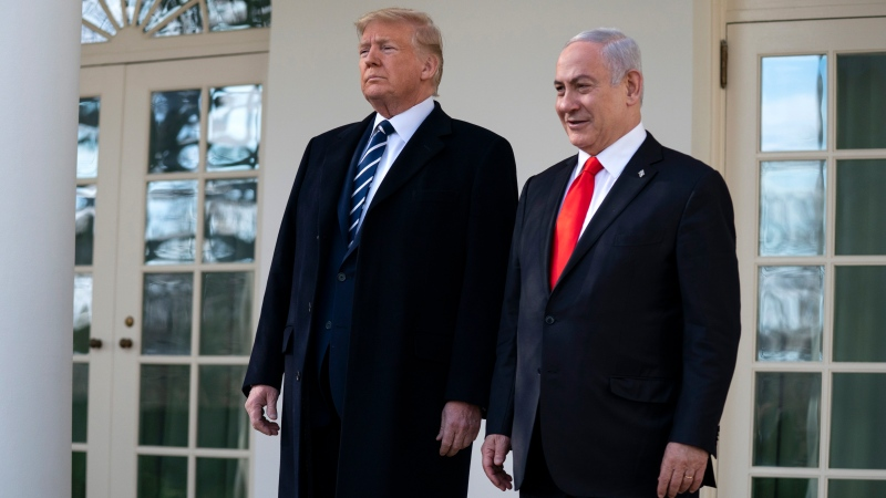 U.S. President Donald Trump and Israeli Prime Minister Benjamin Netanyahu talk with reporters before a meeting in the Oval Office of the White House, Monday, Jan. 27, 2020, in Washington. (AP Photo/ Evan Vucci)