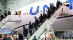 The San Francisco 49ers arrive for the NFL Super Bowl 54 football game Sunday, Jan. 26, 2020, at the Miami International Airport in Miami. (AP / David J. Phillip)
