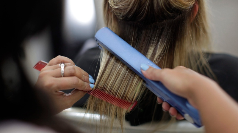 This Feb. 3, 2011 file photo shows a hair dresser at a salon in Brazil. (AP Photo/Felipe Dana, File)
