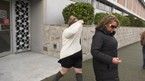 Tenessa Nikirk (left) leaves court Monday after she was found guilty of dangerous driving causing bodily harm to an 11-year-old Saanich girl. (CTV News)