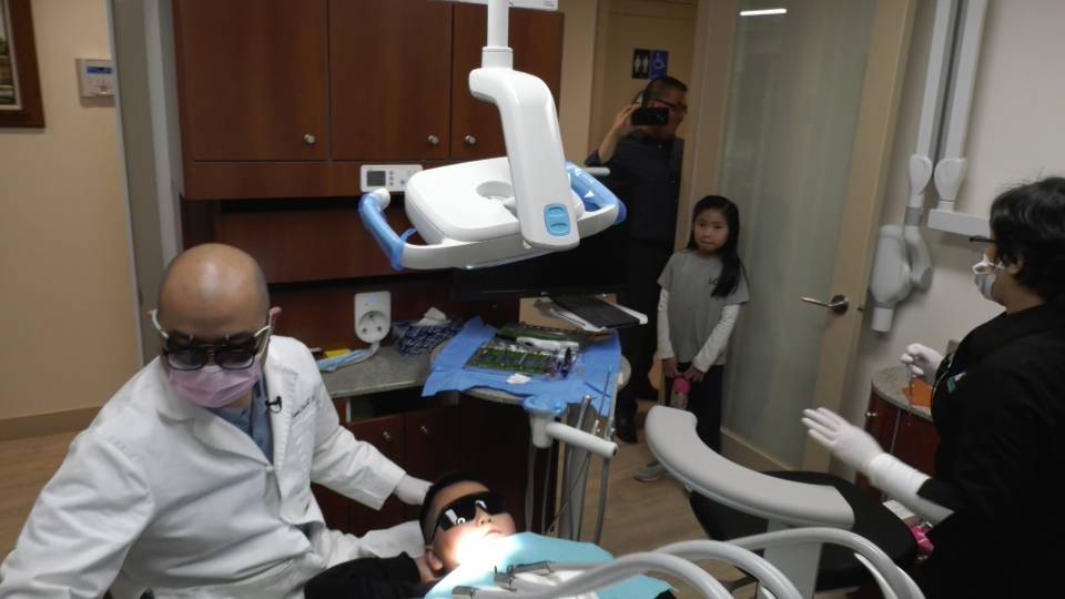 Markus Uy is wearing protective eyewear in advance of having his cavity prepped using laser treatment.
