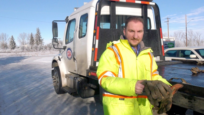 Tow truck operator Trevor Snyder is calling for blue flashing lights to be allowed on tow trucks after witnessing a crash on Highway 2.