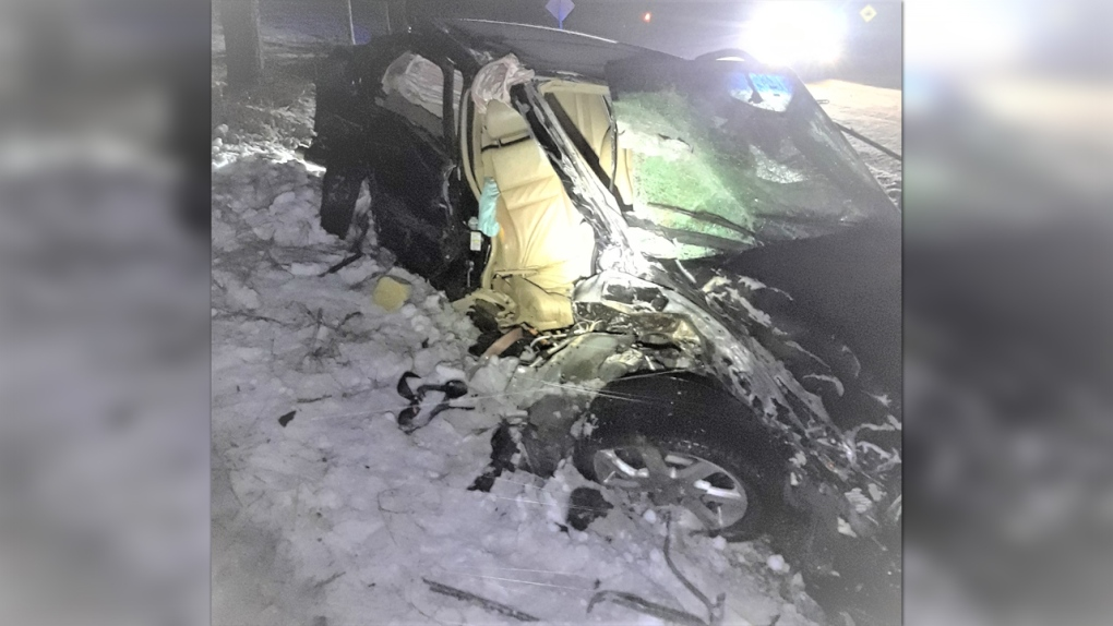 A badly-damaged car in the snow
