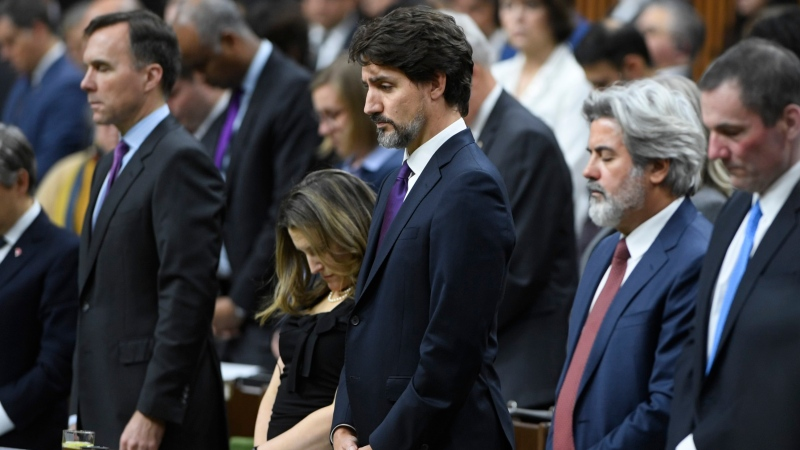 Prime Minister Justin Trudeau and house members observe a moment of silence for the victims of the Ukrainian Airlines plane shot down in Iran, before Question Period in the House of Commons, Monday Jan. 27, 2020 in Ottawa. (THE CANADIAN PRESS / Adrian Wyld)