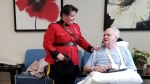Assistant Commissioner and Commanding Officer for the Manitoba RCMP Jane MacLatchy (left) swears in 88-year-old Jack Ervin Russell as an honourary member of the RCMP. (Source: Manitoba RCMP)