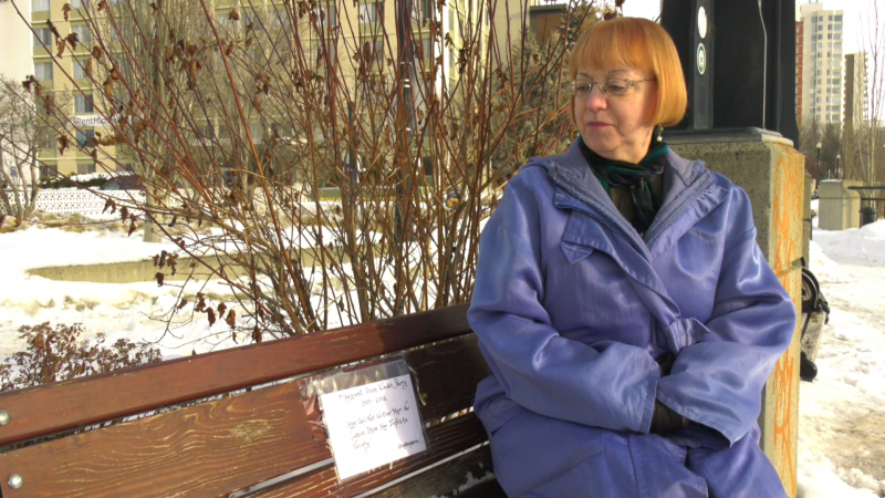 Sheelagh Perry sits on the bench from where a plaque dedicated to her late mother, Margaret Grace Walsh-Perry, was stolen.