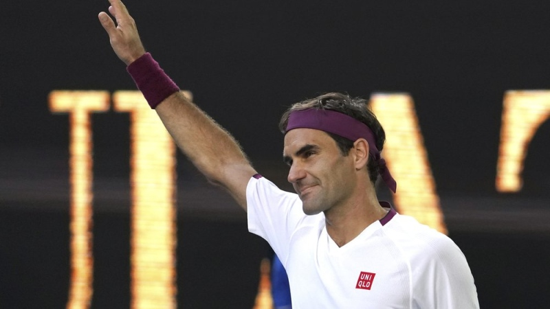 Switzerland's Roger Federer reacts after defeating Tennys Sandgren of the U.S. in their quarterfinal match at the Australian Open tennis championship in Melbourne, Australia, Tuesday, Jan. 28, 2020. (AP Photo/Lee Jin-man)