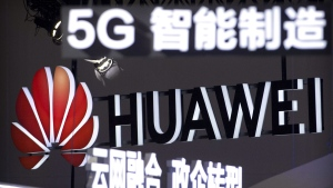 Signs promoting 5G wireless technology from Chinese technology firm Huawei are displayed in Beijing in 2018. (Mark Schiefelbein / AP)