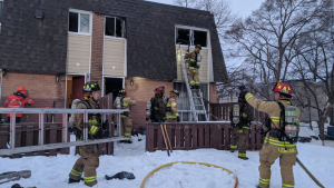 Ottawa firefighters respond to a fire in a row house unit in Ottawa's Carlington neighbourhood, Jan. 28, 2020. (Scott Stilborn/@OFSFirePhoto/Twitter)