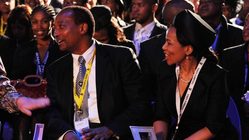 Patrice Motsepe and his wife, Precious Makgosi Moloi, are seen in Qunu, South Africa, Sunday, Dec. 15, 2013. (AP Photo / Felix Dlangamandla, Pool)