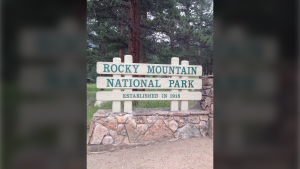 This July 20, 2014 photo shows an eastern entrance to Rocky Mountain National Park in Colorado. (AP Photo/Lindsey Tanner)