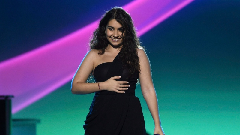 "Alessia Cara performs ""Querer Mejor"" at the Latin Recording Academy Person of the Year gala honoring Juanes at the MGM Conference Center on Wednesday, Nov. 13, 2019, in Las Vegas. Grammy-winning singer-songwriter Alessia Cara will host this year's Juno Awards in Saskatoon. THE CANADIAN PRESS/AP, Chris Pizzello/Invision"
