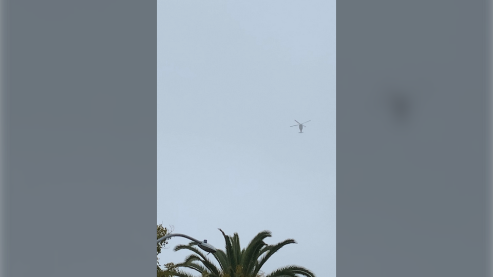 The Sikorsky S-76B helicopter can be seen flying above Glendale, Calif. in foggy conditions on Sunday morning.