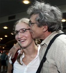 Canadian Tibet protester Melanie Raoul gets a kiss from her dad Yvon upon arriving at Vancouver International Airport in Richmond, August 9, 2007. (CP / Richard Lam)