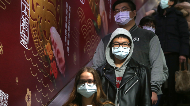 People wear masks at a metro station in Taipei, Taiwan, Tuesday, Jan. 28, 2020. (AP / Chiang Ying-ying)