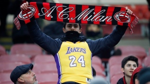 AC Milan's supporter wears a jersey Kobe Bryant prior to the start of the Italian Cup soccer match between AC Milan and Torino in Milan, Italy, Tuesday, Jan. 28, 2020. (AP Photo/Antonio Calanni)
