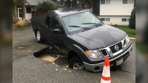 Sue McCartney says that the road collapsed and her vehicle fell into the sinkhole around 9:45 a.m. Tuesday morning: (Submitted)