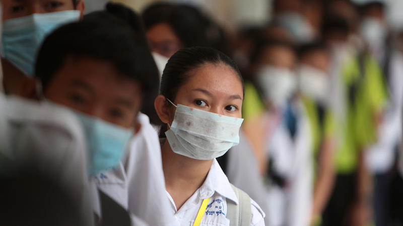 Students line up to sanitize their hands to avoid the contact of coronavirus before their morning class at a hight school in Phnom Penh, Cambodia, Tuesday, Jan. 28, 2020. (AP / Heng Sinith)
