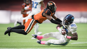 The BC Lions' T.J. Lee (6) hits Toronto Argonauts' James Wilder Jr. (32) during second half CFL football action in Vancouver, Saturday, Oct. 5, 2019. (Darryl Dyck / The Canadian Press)