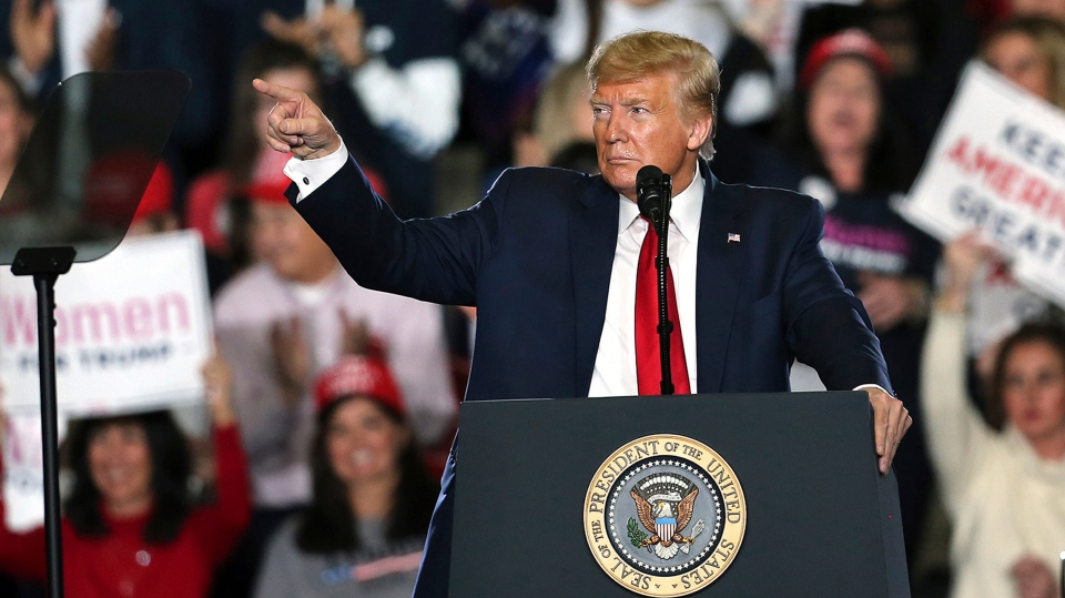 U.S. President Donald Trump waves as he speaks at a campaign rally Tuesday, Jan. 28, 2020, in Wildwood, N.J. (AP Photo/Mel Evans)