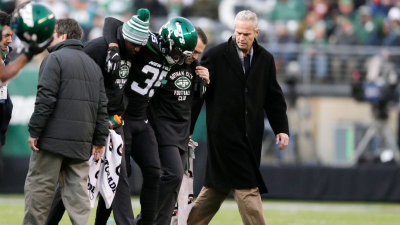 FILE - In this Dec. 8, 2019, file photo, New York Jets cornerback Kyron Brown (35) is helped off the field after being injured during the second half of an NFL football game against the Miami Dolphins in East Rutherford, N.J. (AP Photo/Adam Hunger, File)