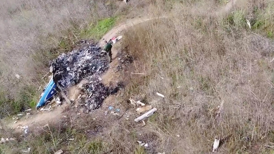 This image taken from video on Monday, Jan. 27, 2020, and provided by the National Transportation Safety Board, shows part of the wreckage of a helicopter crash near Calabasas, Calif. (James Anderson/National Transportation Safety Board via AP)