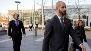 Michael Theriault, centre, and Christian Theriault, left, arrive at the Durham Region Courthouse in Oshawa, Ont., ahead of Dafonte MIller's testimony, on Wednesday, Nov. 6, 2019. THE CANADIAN PRESS/Cole Burston